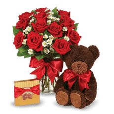 Red roses, chocolates and hugs from a Teddy Bear